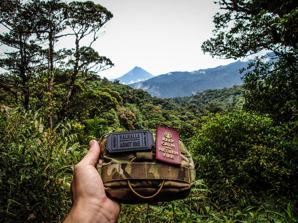 The admin pouch and patches that formed my camera case, in front of the Arenal volcano